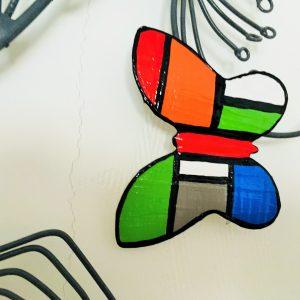 papillon en métal peint 9x8
